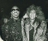 Stevie Wonder and Whitney Houston shared a laugh backstage in 1986.