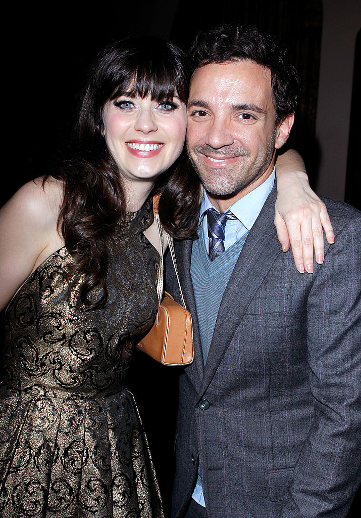 Zooey Deschanel gave a big hug to stylist George Kotsiopoulos.