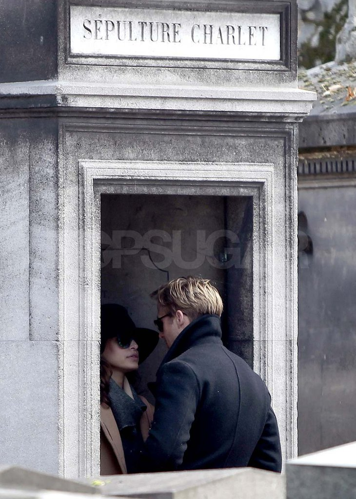 Ryan Gosling with Eva Mendes at a cemetery in Paris.