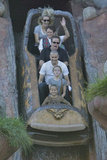 Reese Witherspoon, Jim Toth, Ava, and Deacon on the log ride at Disneyland.