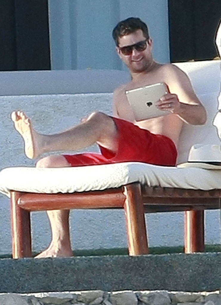 Joshua Jackson reading his iPad.
