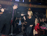 Kate Moss at a charity auction with Boy George.