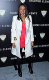Jennifer Hudson layered a crisp white coat over a pink mini dress.
