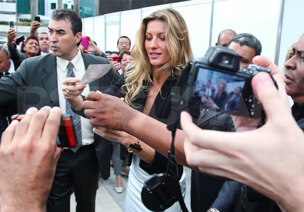 Gisele Bundchen signed autographs for fans in Brazil.