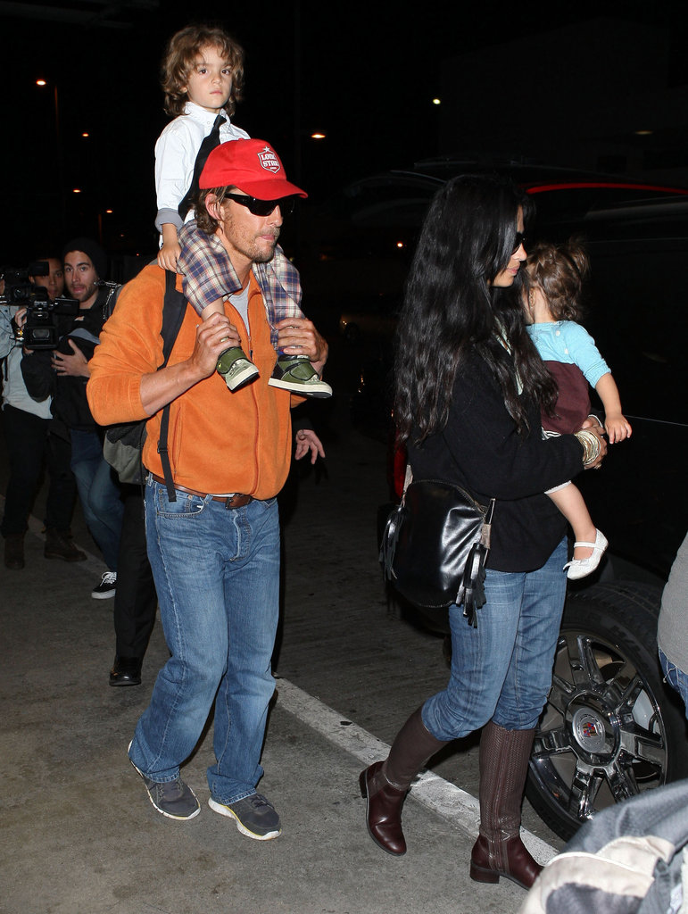 Matthew McConaughey and Camila Alves arrived home in LA with their children.