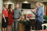 Julie Bowen as Claire, Sofia Vergara as Gloria, Jesse Tyler Ferguson as Mitchell, and Ed O'Neill as Jay on Modern Family.  Photo copyright 2011 ABC, Inc.