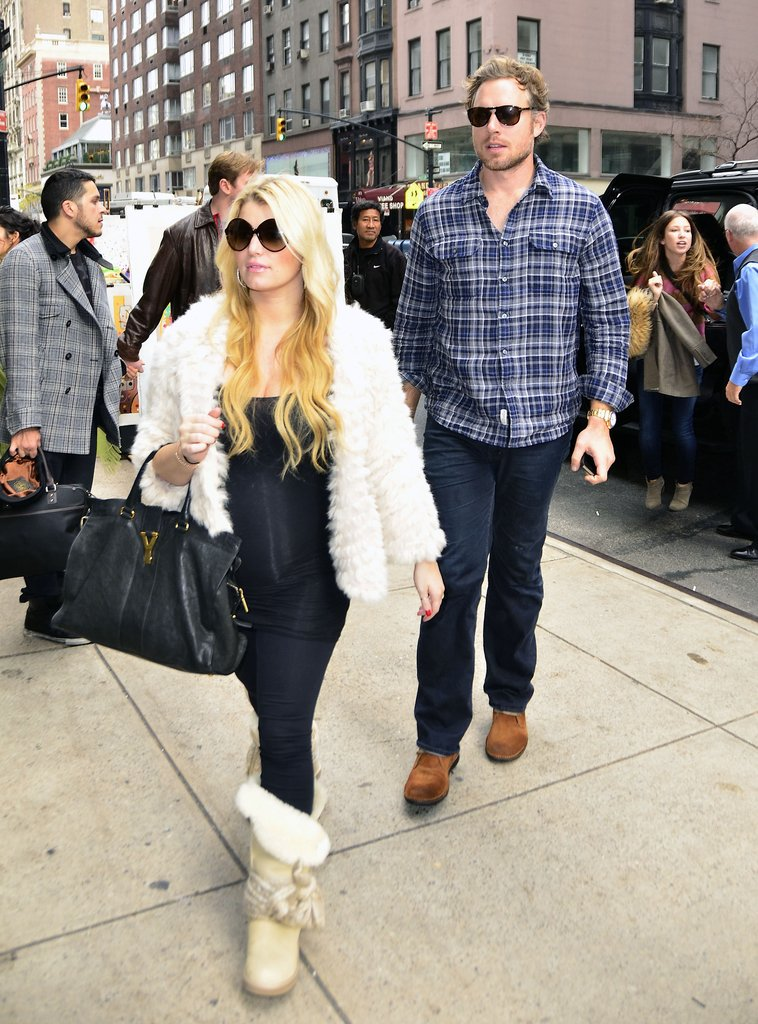 Jessica Simpson wore a furry white coat for her latest shopping adventure.