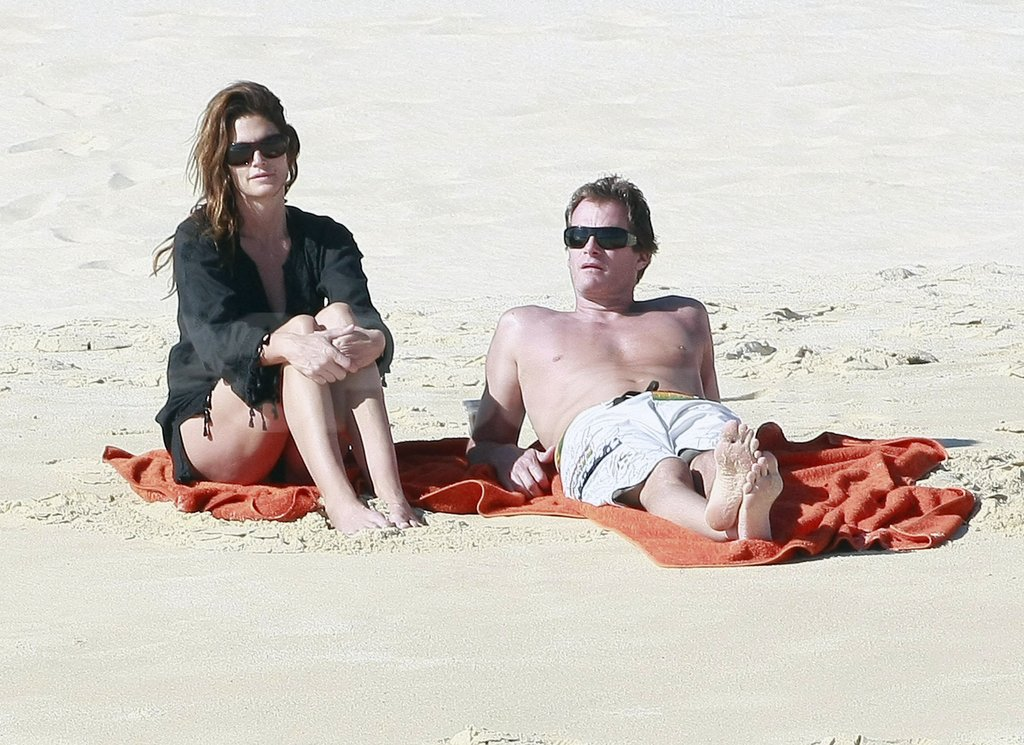 Cindy Crawford took a seat next to shirtless Rande Gerber.