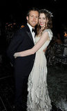 Adam Shulman and Anne Hathaway cuddled up for the White Fairy Tale Love Ball in Paris during July 2011.