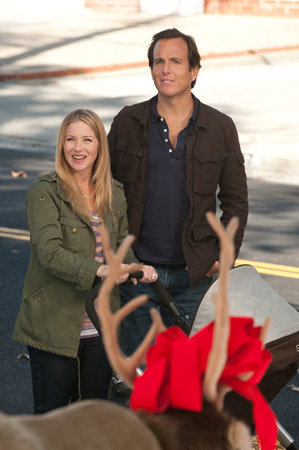 Reagan and Chris take a moment to appreciate the reindeer decorating a front yard.  Photo courtesy of NBC