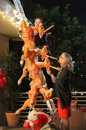 Reagan teams up with her mom (Blythe Danner) to add some Christmas cheer to her front yard.  Photo courtesy of NBC