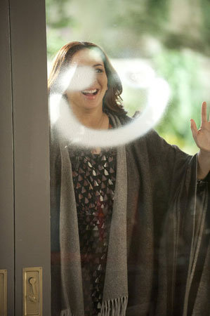 Ava looks just as happy as the smiley face decorating the Brinkley's front door.  Photo courtesy of NBC