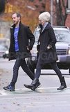Anne Hathaway and Adam Shulman walking in NYC.