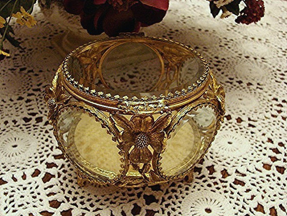 This intricate, one-of-a-kind jewelry box is just as beautiful as the pieces it will house. Vintage Jewelry Box Matson Ormolu Jewelry Casket ($95)