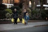 Kate Hudson and Matthew Bellamy carrying groceries with Ryder.
