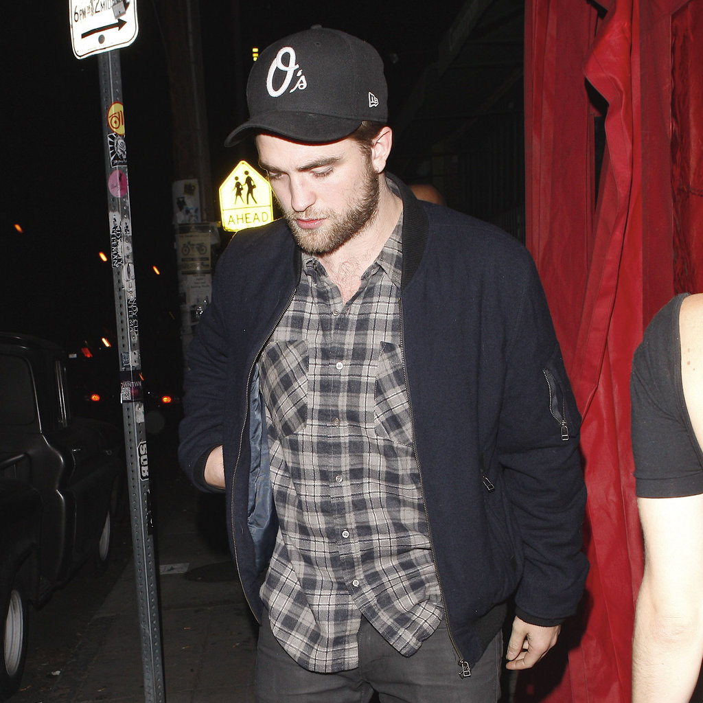 Robert Pattinson in a plaid shirt.
