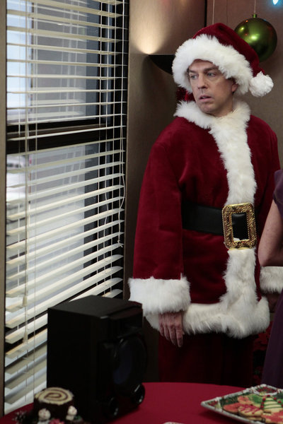 Andy looks a little stressed out about playing Santa this year.  Photo courtesy of NBC