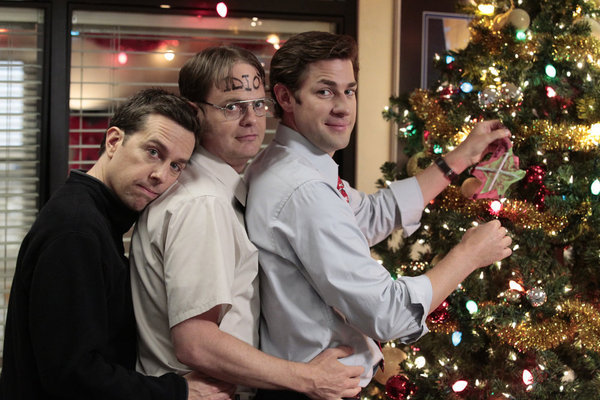 "I have no idea why Dwight's forehead says ""idiot,"" but it makes me love this adorable tree-trimming photo even more.  Photo courtesy of NBC"