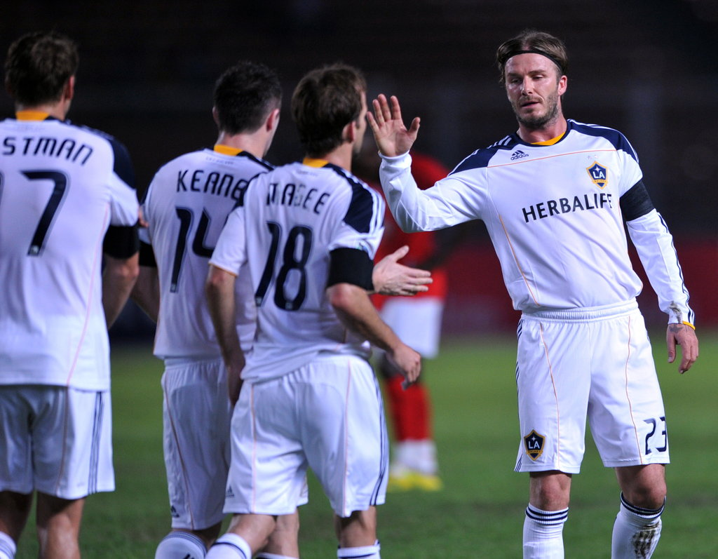 David Beckham celebrated with his teammates during a match against the Indonesia Selection team in Jakarta on Nov. 30.
