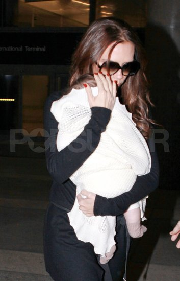 Victoria Beckham carried her daughter Harper Beckham at LAX.