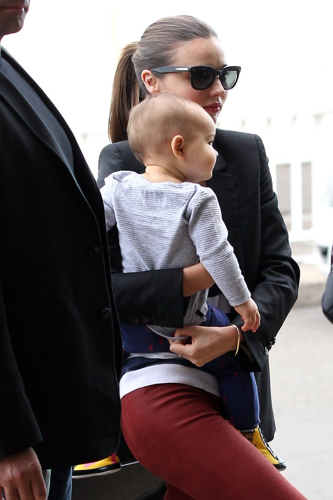 Miranda Kerr carrying Flynn Bloom at the airport.