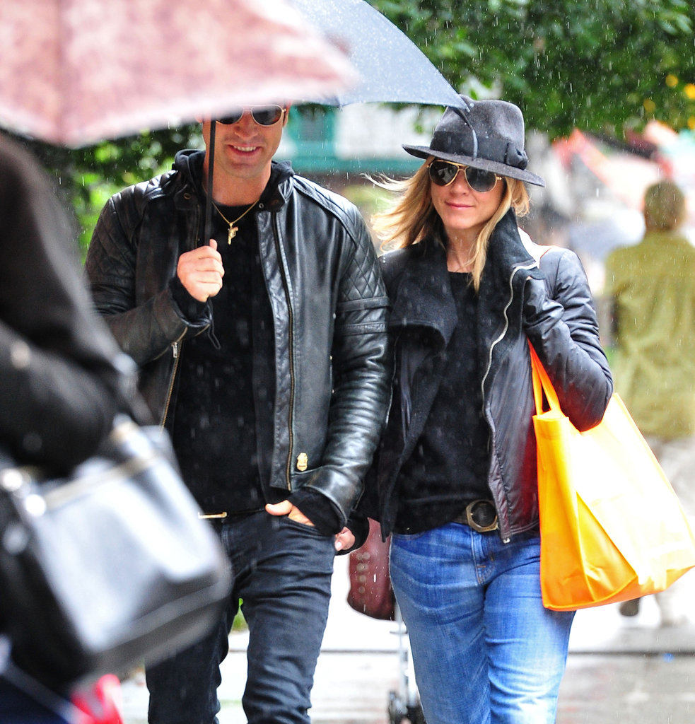 Justin held an umbrella over the couple as they ventured out during a rainy NYC day in September 2011.