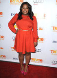Amber Riley looked sweet in a red party dress and bow-adorned bright pink heels for the Trevor event.