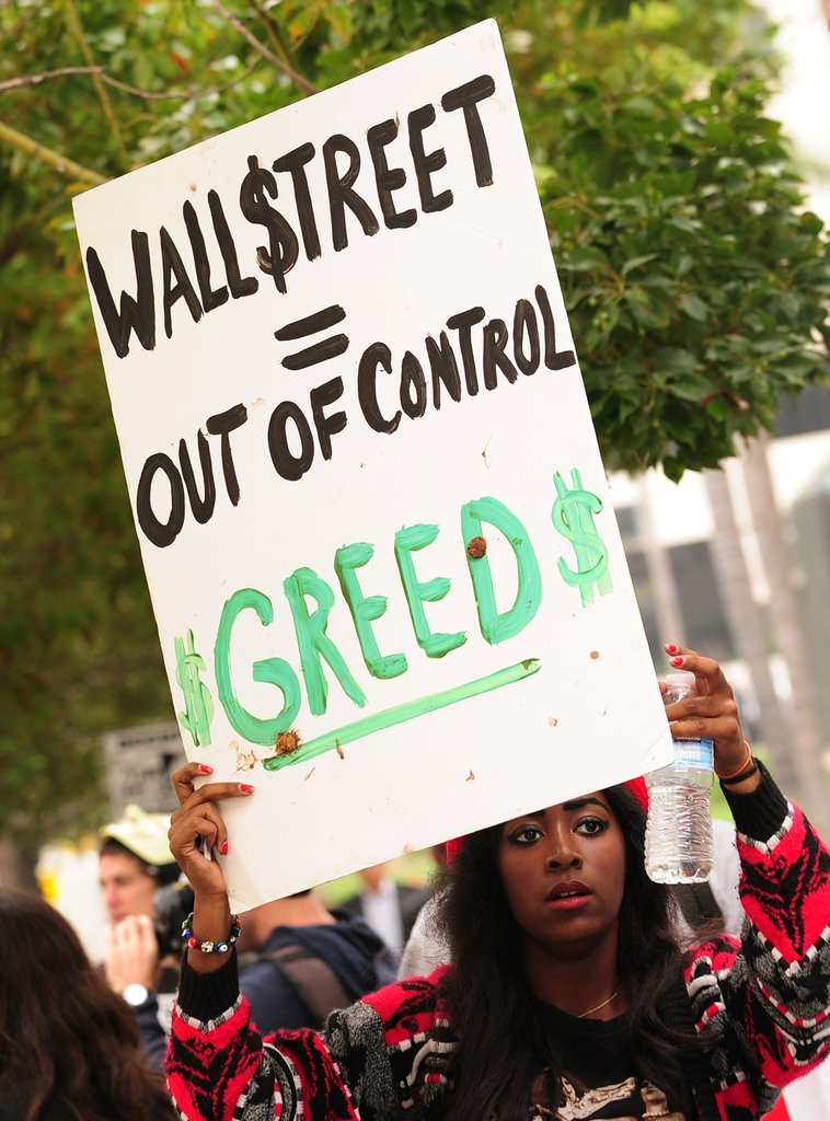 A woman protested Wall Street in Los Angeles, CA.