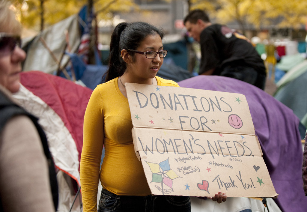 A young woman asked for donations for women's needs in New York.
