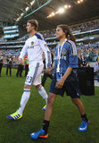 David Beckham walked onto the field with a fan.