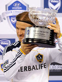David Beckham raised his newly acquired trophy.