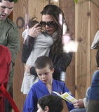 Victoria Beckham carried Harper to Cruz's karate practice.