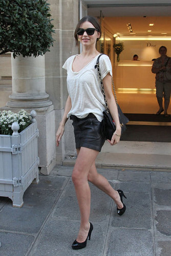 If you've ever feared the sexy factor of a leather miniskirt, take notes from Miranda — a basic white tee tempers the vibe with an easy effect.