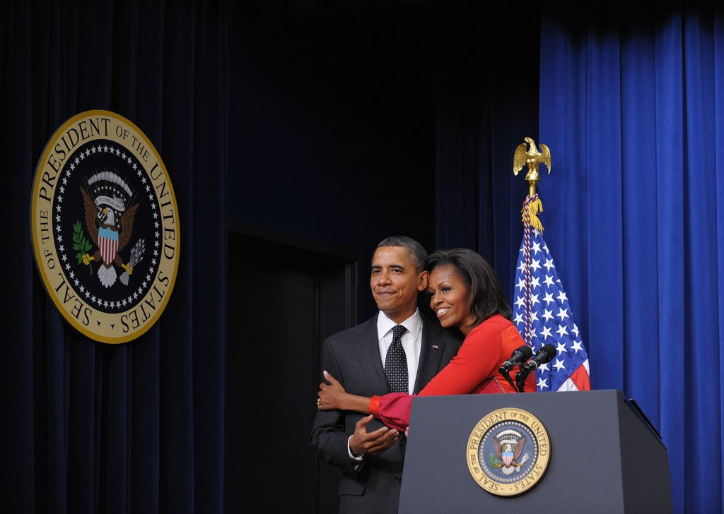 Michelle hugs Obama tight during an event in November.