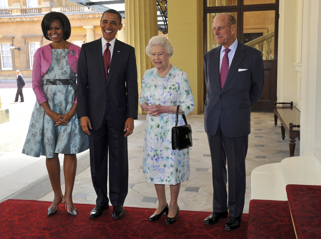 The Obamas look cheery during an event with the Queen and Prince Philip.