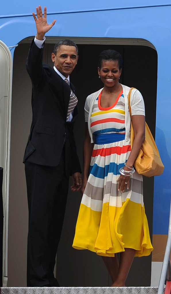Michelle was colorful and by her man's side as they departed Brazil.