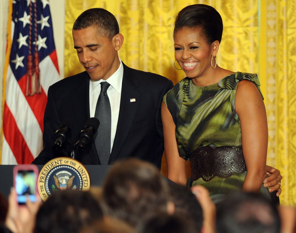Michelle smiled big as her husband joked with her during a Cinco de Mayo reception.