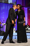 The president planted one on Michele at the Congressional Black Caucus Foundation Annual Phoenix Awards dinner in September.