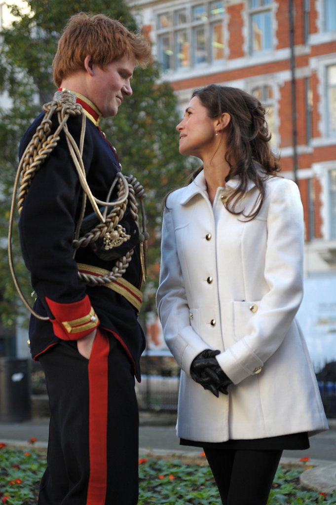 Harry and Pippa look-alikes glance at each other.