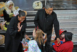 The president and first lady offer treats to the little kids at the White House before Halloween.