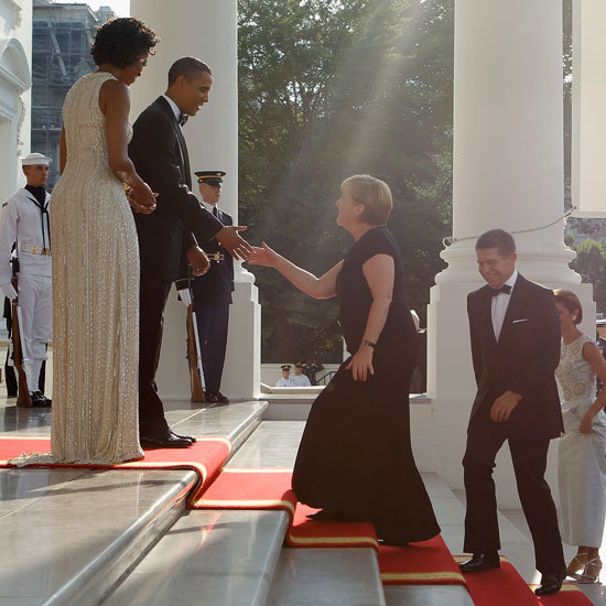 The Obamas great German chancellor Angela Merkel for a state dinner at the White House.