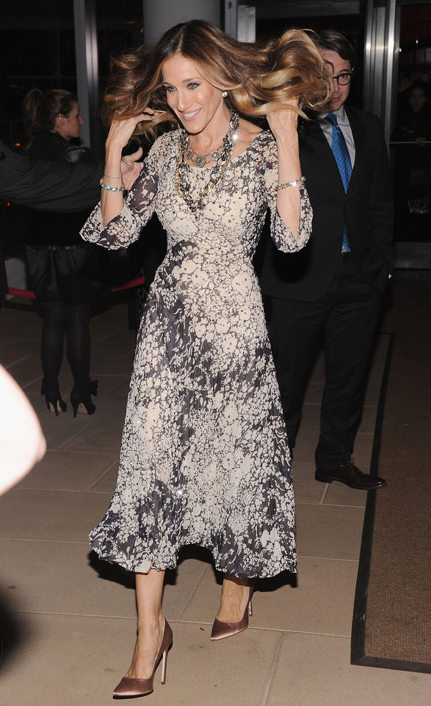 Sarah Jessica Parker fluffed her hair on her way into a fashion party.