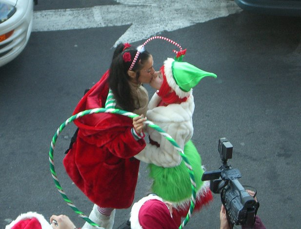 Santa's elves make out.   Source: Flickr User urbanblitz