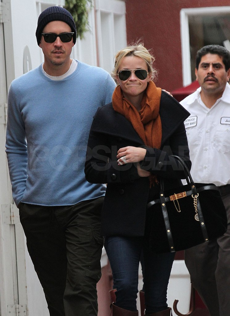 Reese smiled leaving her lunch date with Jim.