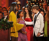 Justin Bieber greets the Obama girls.