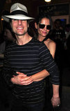 Katie Holmes gave Tom Cruise a squeeze from behind while hanging in Miami in June 2011.