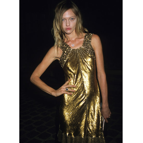 Sasha Pivovarova wore a high-shine Roberto Cavalli cocktail dress to the designer's 40th anniversary party during Spring 2011 Paris Fashion Week. Shop the look: