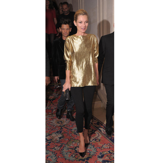 Kate Moss paired a slouchy gold tunic with a pair of leggings and pointy-toed pumps at the Fred Jewelry launch during Paris Fashion Week in October 2011.  Shop the look:
