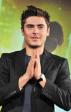 Zac dressed in a dark jacket for the New Year's Eve press conference.