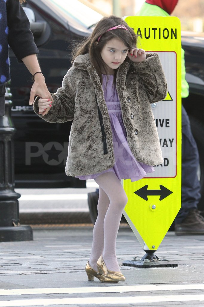 Suri Cruise held hands in a crosswalk.